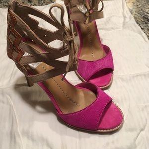 Dolce Vita front-lace sandals.